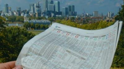 Investor reading a newspaper