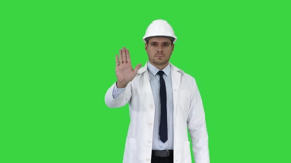 Thumbnail for Science Engineer in Helmet Showing Stop Sing and Then Makes an Attention Gesture on a Green Screen