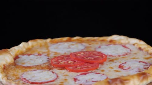 Close Up Yellow Pepperoni Pizza with Mozzarella Cheese Tomato Sauce Pepper Spices and Fresh Onion