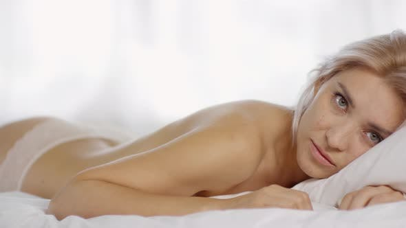 Thumbnail for Blonde Woman in Lacy Panties Posing on Bed