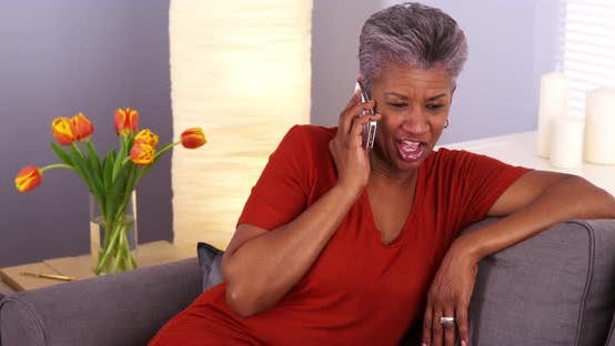 Thumbnail for African grandmother talking on smartphone