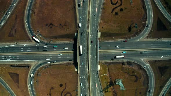 road junction top view. Small road junction moving cars and heavy trucks