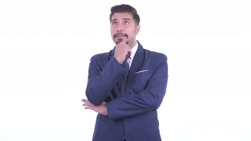 Happy Bearded Persian Businessman Thinking