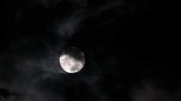 Thumbnail for Timelapse with Full Moon Moving Between Clouds