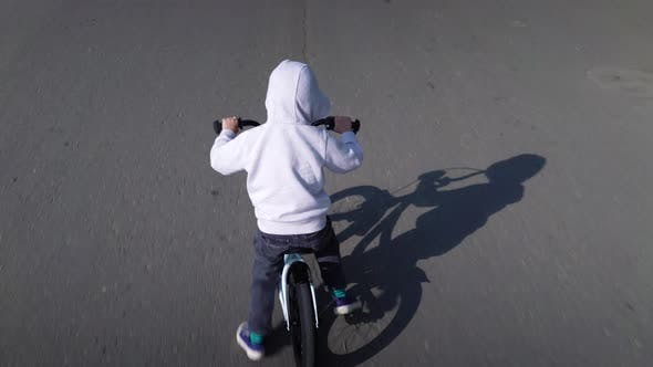 Thumbnail for Cute 3 - 4 Years Boy Child Learning To Ride First Running Balance Bike.