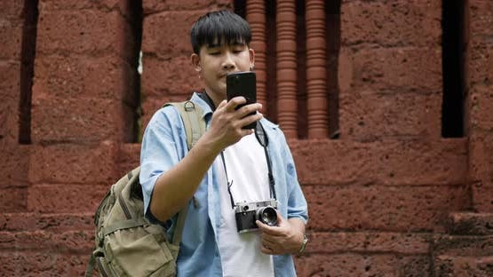 Man checks location on smartphone online map