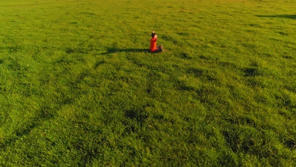 Thumbnail for Low Altitude Radial Flight Over Sport Yoga Man at Perfect Green Grass. Sunset in Mountain