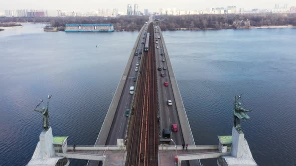 Thumbnail for Metro Train Moving on Bridge Railway. Aerial View Car Traffic on Highway Bridge