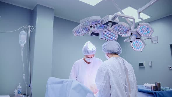 Cover Image for Medical Team Performing Surgical Operation in Bright Modern Operating Room