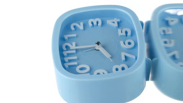 Vertical Video Blue Alarm Clock Showing Eight O'clock Spinning Rotating 360 Isolated on White