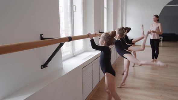 Thumbnail for Ballet Coach Teaching Little Girls in Studio