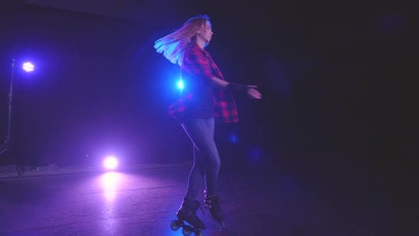 Close-up Panoramic View of Beautiful Young Roller Skater Woman, Technically Spinning on Front Wheels