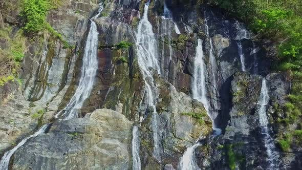 Thumbnail for Drone Approaches Wonderful Waterfall Streaming on Rocks