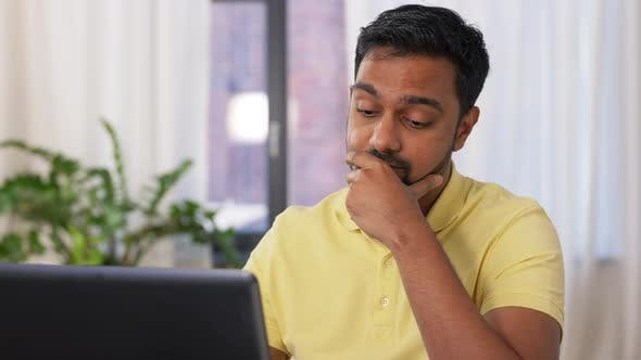 Thumbnail for Indian Man with Laptop Working at Home Office