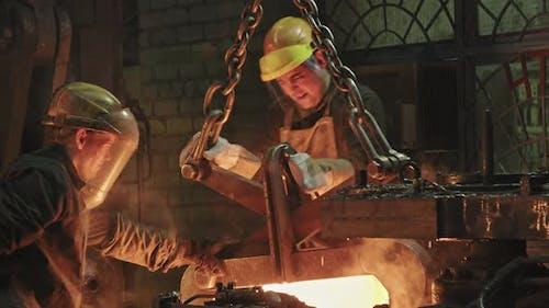 Blacksmiths Working With Heated Steel