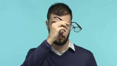 Slow Motion of Surprised and Confused Businessman Take Off Glasses Blinking and Staring with