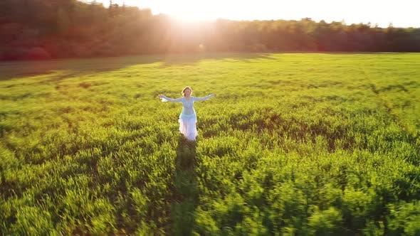 Thumbnail for Girl Walking On Sunlight Field
