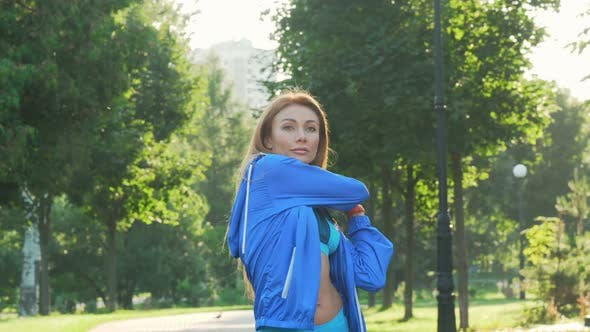 Cover Image for Beautiful Sportswoman Warming Up Before Jogging in the Park