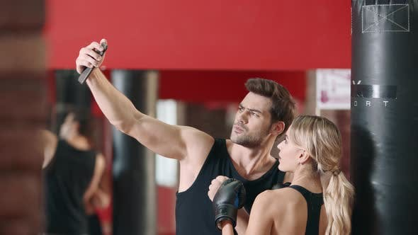 Fitness Instructor Doing Mobile Selfie with Woman Boxer After Training