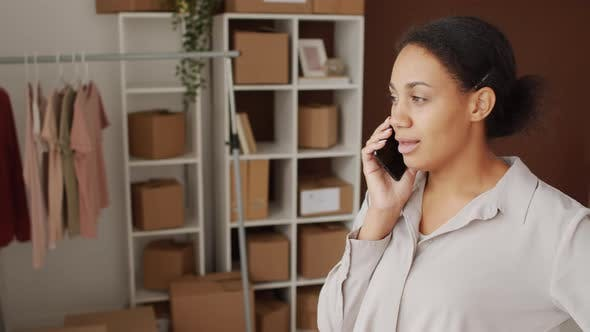 Black Woman Talking on Phone