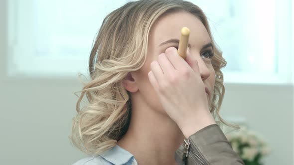Thumbnail for Make-up Artist Doing Make-up of a Beautiful Young Blond Girl, Applies Powder with Big Brush