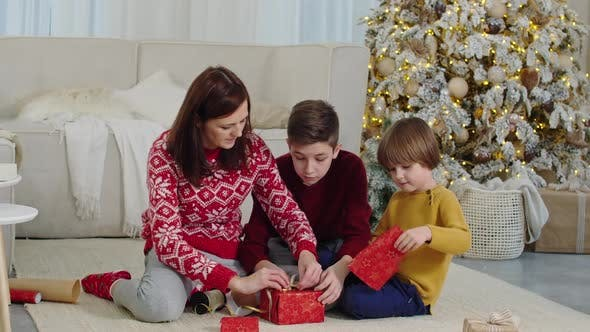Thumbnail for Happy Family Wrapping Christmas Presents