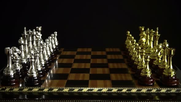 Cover Image for Chess Figures On A Chessboard On A Black Background 1.