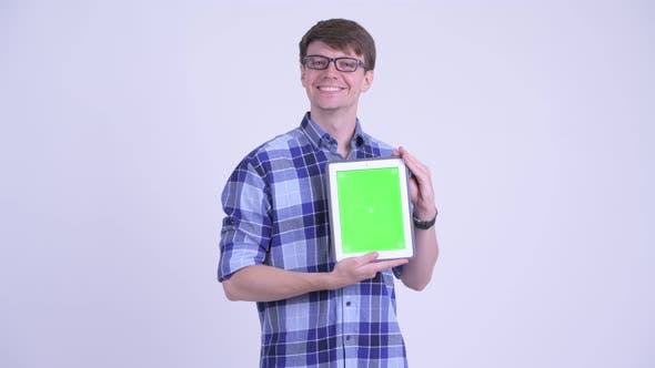 Thumbnail for Happy Young Handsome Hipster Man Thinking While Showing Digital Tablet