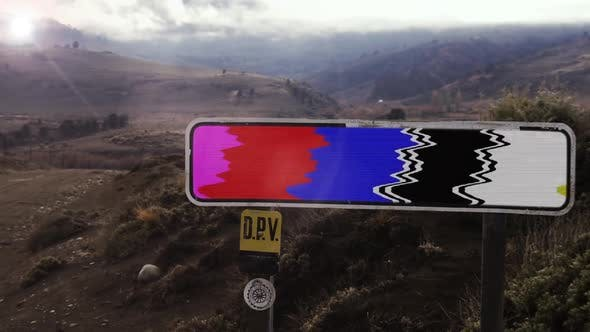 Thumbnail for Road Sign with Color Bars on a Mountain Background.