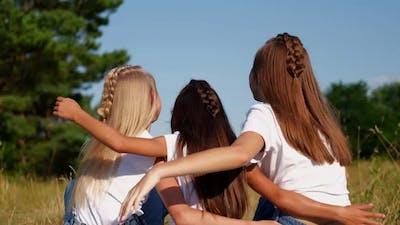 Three Teenage Sisters Hugged Each Other