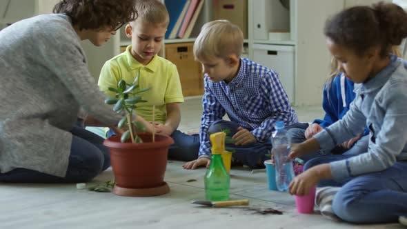 Kids Watering Plants in Kindergarten