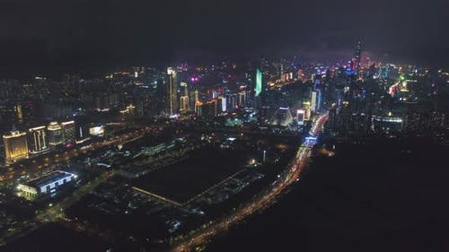 Shenzhen City at Night. Futian District and Shenzhen Bay. China. Aerial View