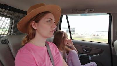 Sad Woman And Girl In Car