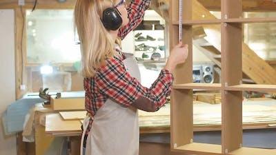 Beautiful Woman Work As Woodworker in Workshop
