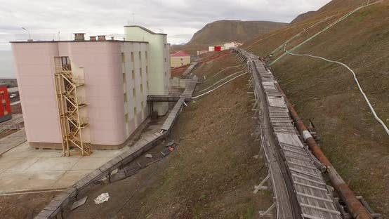 Thumbnail for Drone Flight Over the Pipe Stretching By the Ground Along the Settlement of Barentsburg. Spitsbergen
