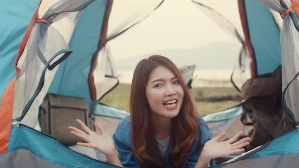 Asia teenagers girl influencer record footage introduce and camp place to her follower enjoy.