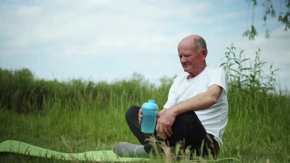 Thumbnail for Healthy Eating, Elderly Man Leads Healthy Lifestyle and Drinks Clean Water in Sports Bottle After