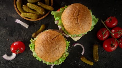 Burgers with Tomatoes and Pickles Rotate.