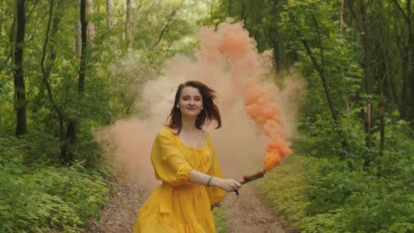 Thumbnail for Joyful Woman Whirling in Clouds of Color Smoke
