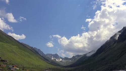 High Snowy Mountains on the Background of Glacial U Valley and Alpine Meadows