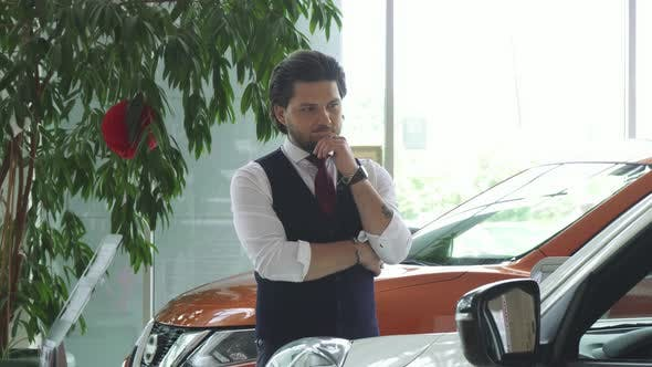 Thumbnail for Young Handsome Businessman Examining Cars for Sale at the Dealership