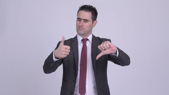 Thumbnail for Handsome Businessman Choosing Between Thumbs Up and Thumbs Down