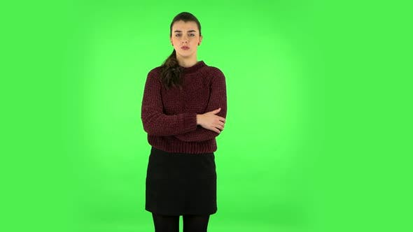 Thumbnail for Female Listens Attentively and Nods His Head Pointing Finger at Viewer, Green Screen