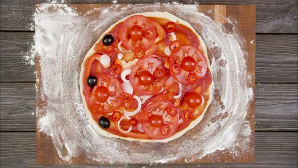 Thumbnail for Top View of Vegetarian Pizza on Wooden Plate on the Table, Stop Motion Animation