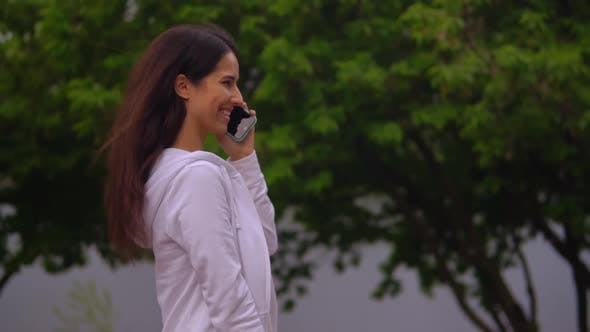Thumbnail for Businesswoman Has Phone Negotiations on The Run