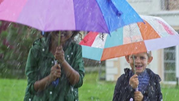 Thumbnail for Happy Children Jumping in Rain
