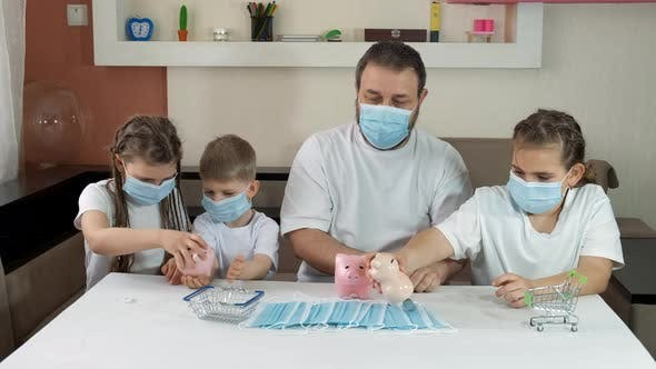 Dad and Children in Medical Masks Take Coins Out of Piggy Banks