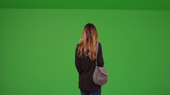 Thumbnail for Young millennial girl messaging on cell phone on green screen