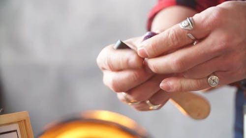 Jeweler Selecting Necessary Polishing Equipment.
