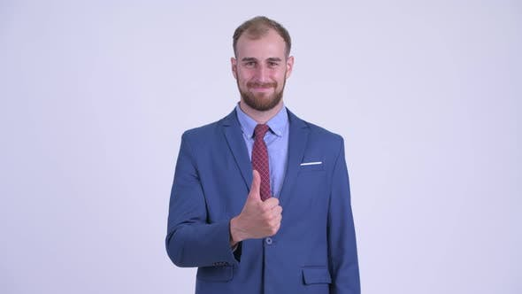 Happy Bearded Businessman Giving Thumbs Up